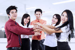 Business team joining hands in office Royalty Free Stock Photo