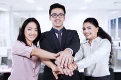 Business team joining hands in the office Royalty Free Stock Photo