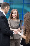 Business team joining hands. Teamwork concept. Successful happy business people joining hands working together. Focus on smiling businesswoman. Successful Deal Stock Image