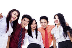 Asian business team in a huddle Stock Image