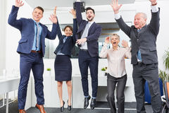 Business team jumping in celebration. With enthusiasm for recent success Royalty Free Stock Photos