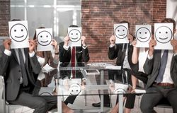 Business team keeps smiley icons sitting at the Desk. Business concept royalty free stock images