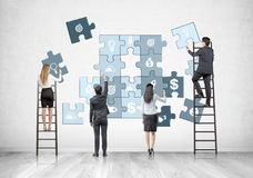 Business team on ladders, business puzzle Royalty Free Stock Photography