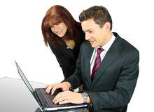 Business Team with a Laptop. Business Partners Looking at a notebook on a Glass Table Royalty Free Stock Images