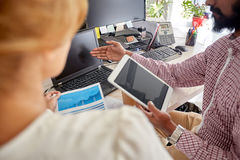 Business team with laptop, chart and tablet pc Royalty Free Stock Photo