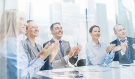 Business team with laptop clapping hands Royalty Free Stock Images