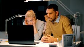 Business team with laptop and files at dark office stock footage