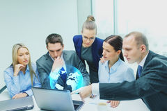 Business team with laptop having discussion Royalty Free Stock Images