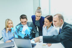 Business team with laptop having discussion Stock Photos