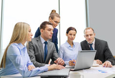 Business team with laptop having discussion Royalty Free Stock Photo