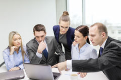 Business team with laptop having discussion Royalty Free Stock Image