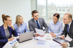 Business team with laptop having discussion Royalty Free Stock Photography