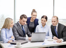 Business team with laptop having discussion Stock Photo