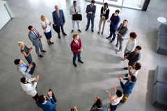 Business team with leader in centre of circle Stock Images