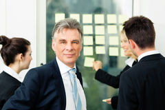 Business Team with leader in office Stock Photography