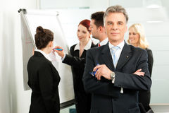 Business Team with leader in office Stock Photos