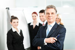 Business Team with leader in office Stock Photo