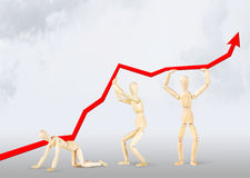Business team lifting graph upwards Stock Photo