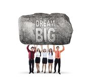 Business team lifting text of dream big Royalty Free Stock Image