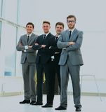 Business team in a line smiling at the camera. Business team in a line smiling at the camera Stock Photo