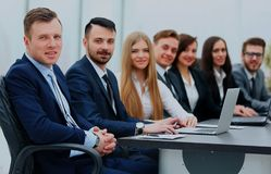 Business team in a line smiling at the camera. Business team in a line smiling at the camera Royalty Free Stock Images