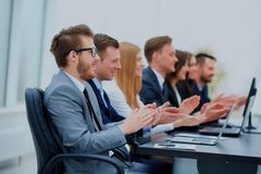 Business team in a line smiling at the camera. Photo of happy business people applauding at conference Stock Photos