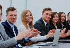 Business team in a line smiling at the camera. Photo of happy business people applauding at conference Royalty Free Stock Images