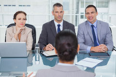 Business team listening to the applicant in interview Stock Photos