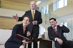 Business team in lobby meeting with senior manager royalty free stock photography