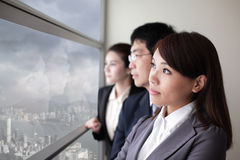 Business team look city through window Stock Photos