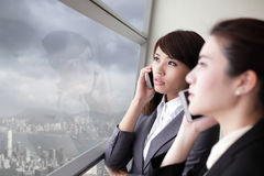 Business team look city through window Royalty Free Stock Photo