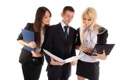 The business team look in the folder Royalty Free Stock Image