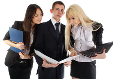 The business team look in the folder Royalty Free Stock Photography