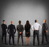 Business team look at the wall Royalty Free Stock Image