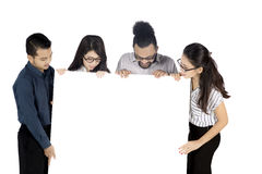 Business team looking at a blank banner Stock Photos