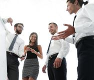 Business team looking at a blank flipchart. Royalty Free Stock Image
