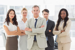 Business team looking at camera with arms crossed Stock Image