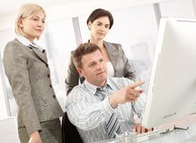 Business team looking at computer Royalty Free Stock Photos