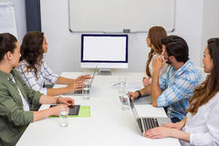 Business team looking at computer screen in the meeting room Royalty Free Stock Image