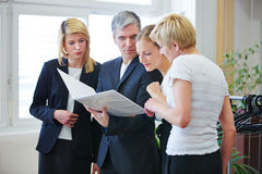 Business team looking at contract in meeting Royalty Free Stock Photography