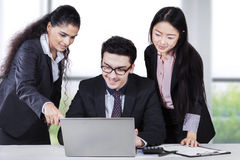Business team looking document on laptop Stock Photos