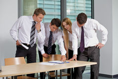 Business team looking at document in office Royalty Free Stock Photos