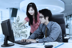 Business team looking at dollars cash on computer Royalty Free Stock Photography