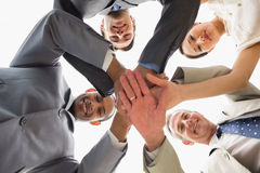 Business team looking down at the camera with hands together Stock Images