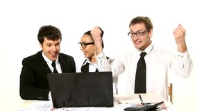 Business team looking at laptop in anticipation stock video