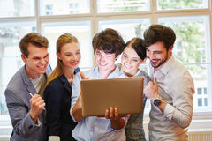 Business team looking at monitor. Business team looking at computer monitor in their successful start-up Royalty Free Stock Images