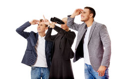 Business team looking into one direction-woman using binoculars Royalty Free Stock Photography