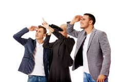 Business team looking into one direction-woman using binoculars Royalty Free Stock Images