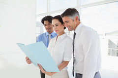 Business team looking over files Royalty Free Stock Photography