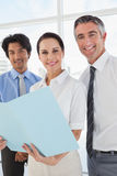 Business team looking over files Stock Image